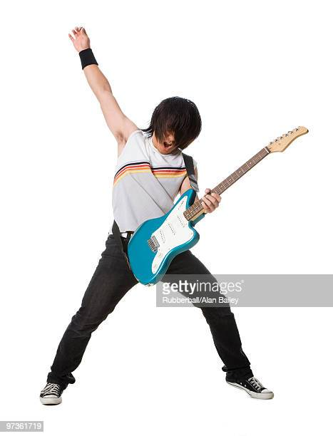 young man playing electric guitar - パンクロック ストックフォトと画像