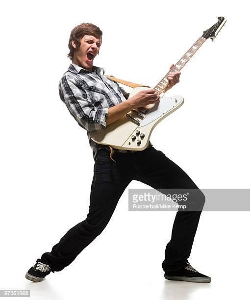 Young man playing electric guitar, shouting