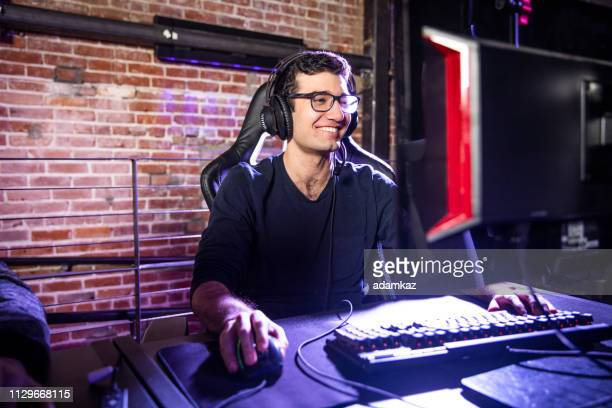 young man playing esports - esport stock pictures, royalty-free photos & images