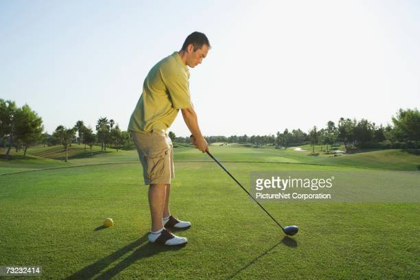 young man playing golf on golf course - teeing off stock pictures, royalty-free photos & images