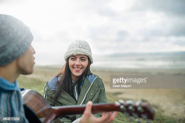 young man playing guitar, brean sands, somerset, england - sean malyon stock pictures, royalty-free photos & images
