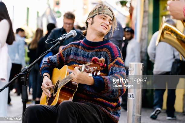 young man playing guitar in the street - galway stock pictures, royalty-free photos & images