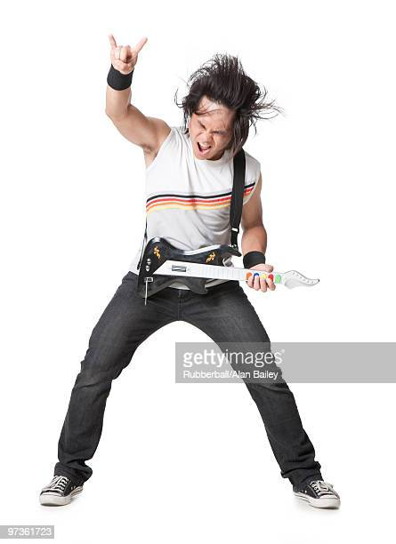 young man playing guitar video game, portrait - guitar hero stock photos and pictures