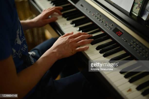 young man playing piano - キーボード奏者 ストックフォトと画像