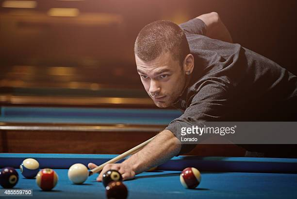 Young man playing pool