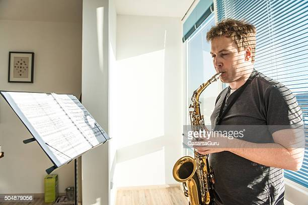 Young Man Playing Saxophone at Home