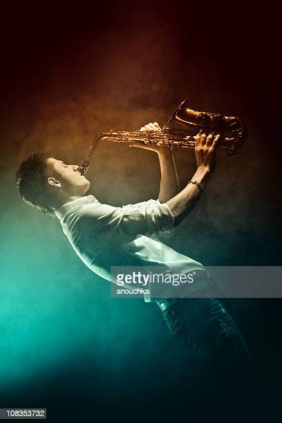 young man playing saxophone - music style stock pictures, royalty-free photos & images