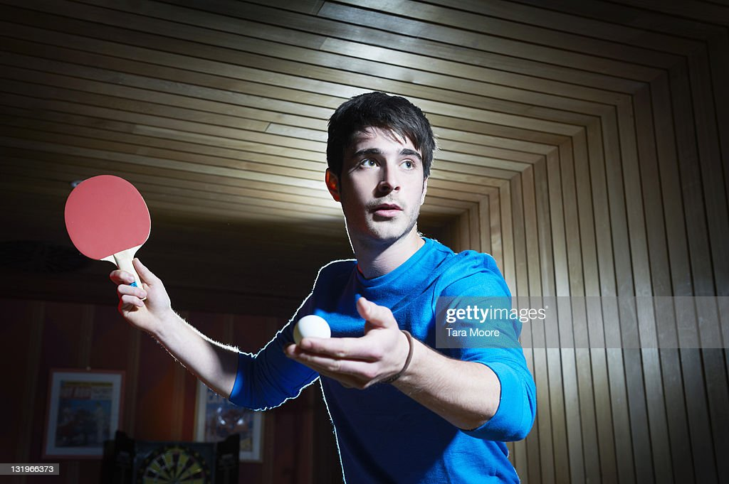 young man playing table tennis : Stock Photo