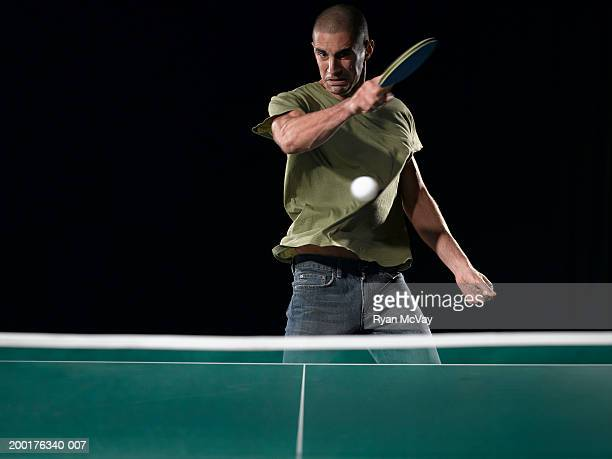 Young man playing table tennis (blurred motion)