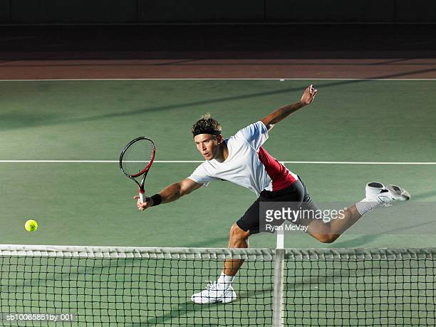 young man playing tennis - tennis stock-fotos und bilder