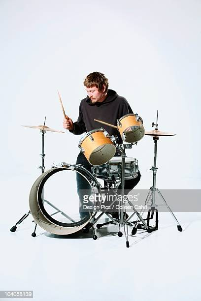 a young man playing the drums - drum kit stock pictures, royalty-free photos & images