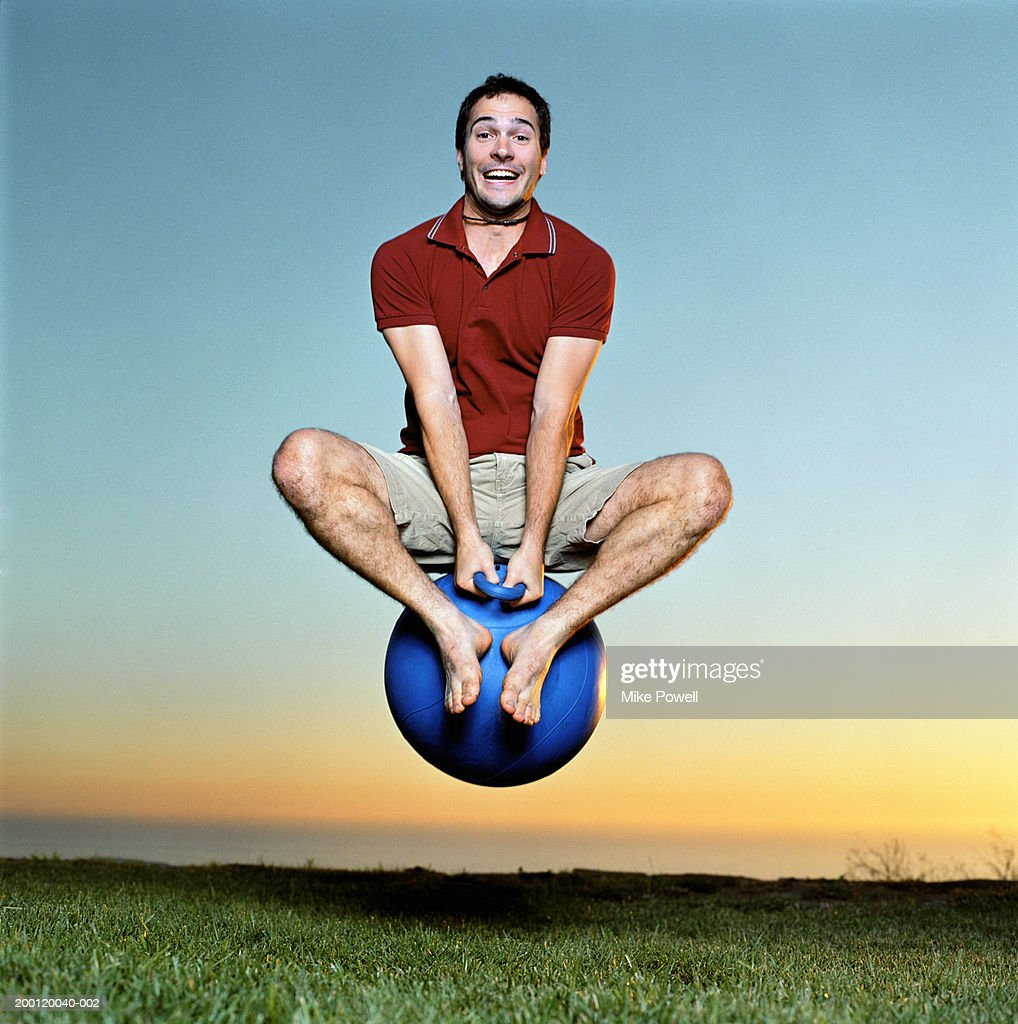 Young man playing with bounce and hop ball : Stock Photo
