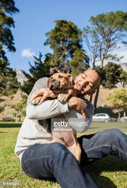 Young man playing with his dog at the park.