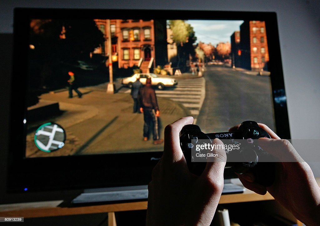 Player Tries To Master The Newly Released Grand Theft Auto IV : News Photo