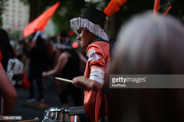 A young man plays the drum in support of the cause of women against violence in Santiago of Chile on 22 November 2018 in support of the feminist...
