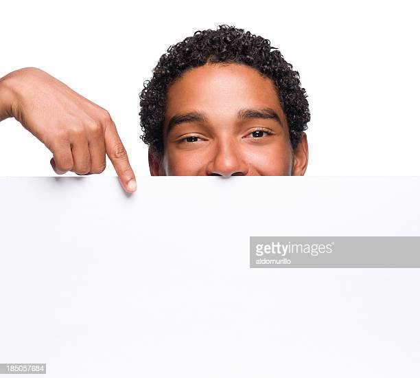 young man pointing at a blank sign - blank sign stock photos and pictures