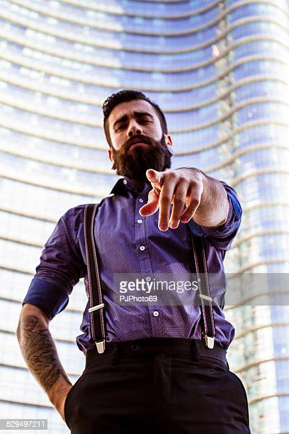 young man (hipster style) pointing finger - pjphoto69 stock pictures, royalty-free photos & images
