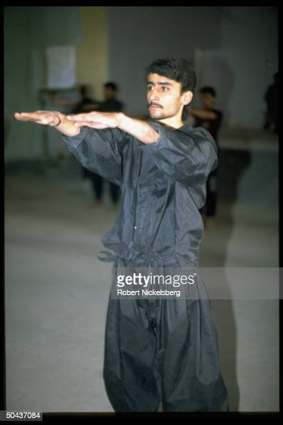 Young man poised in Tae Kwan Do movement, working out at club in Kandahar, Afghanistan.