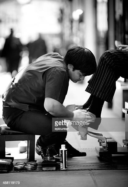 Young man polishing shoes in the Burlinton Arcade