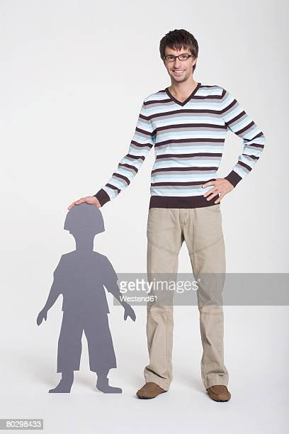 Father with son, smiling, portrait, composite