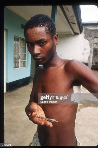 A young man poses with the spearhead that wounded him April 20 1992 in Molo Kenya Incited by President Moi followers of the ruling Kenyan African...