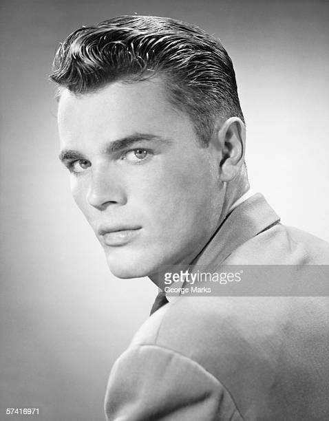young man posing in studio, (b&w), (close-up), (portrait) - 20th century stock pictures, royalty-free photos & images