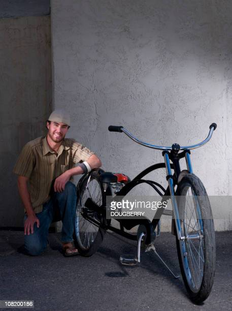 young man posing with bicycle - low rider stock pictures, royalty-free photos & images