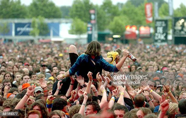 A young man practices crowd surfing during a concert at the Rock Werchter music festival 02 July 2005 in Werchter AFP PHOTO BELGA VIRGINIE LEFOUR
