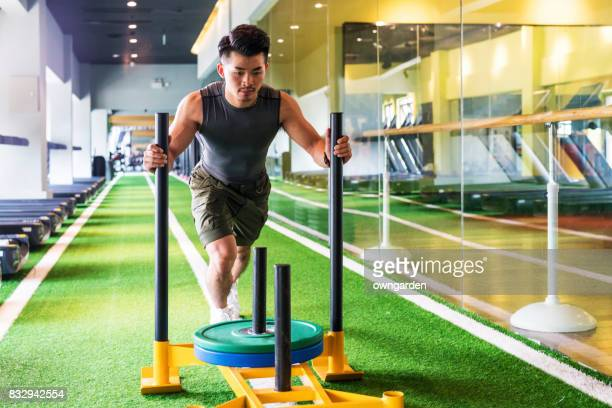 young man practicing gym - circuit training stock photos and pictures