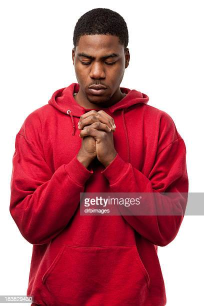 Young Man Praying With Hands Clasped
