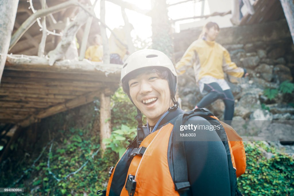 Young man prepared and ready to go white water river rafting : Stock Photo
