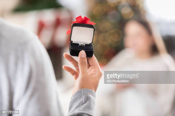 Young man prepares to propose to girlfriend
