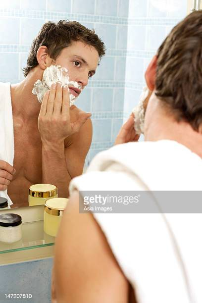 Young man preparing to shave