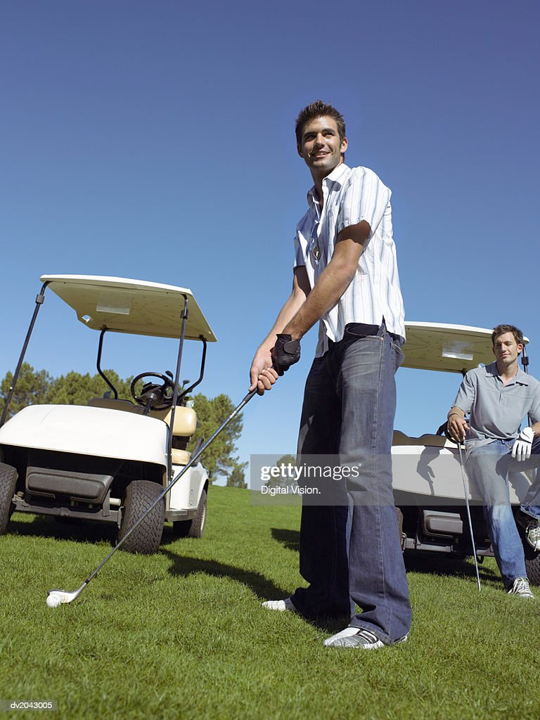 Young Man Preparing to Take a Golf Swing : Stock Photo