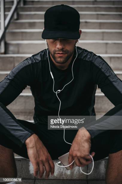 young man preparing to workout - cap stock pictures, royalty-free photos & images
