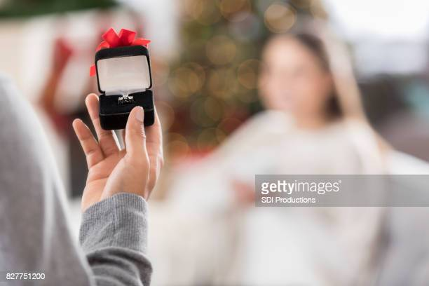 young man presents engagement ring to girlfriend - engagement ring box stock photos and pictures