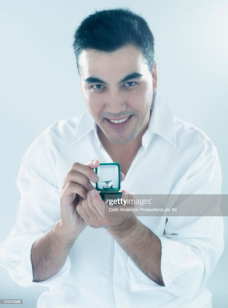 Young man proposes to camera : Stock Photo