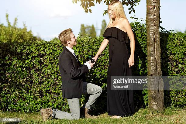 Young man proposing marriage to young woman