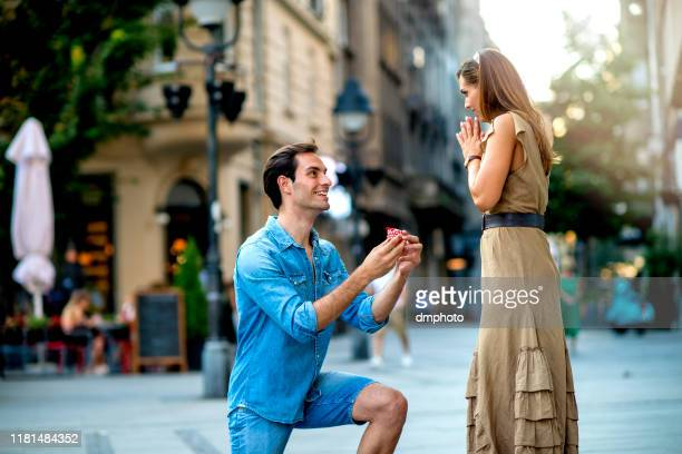 young man proposing to a woman - community engagement stock pictures, royalty-free photos & images