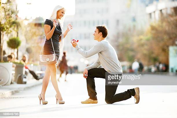 young man proposing to a woman. - community engagement stock pictures, royalty-free photos & images