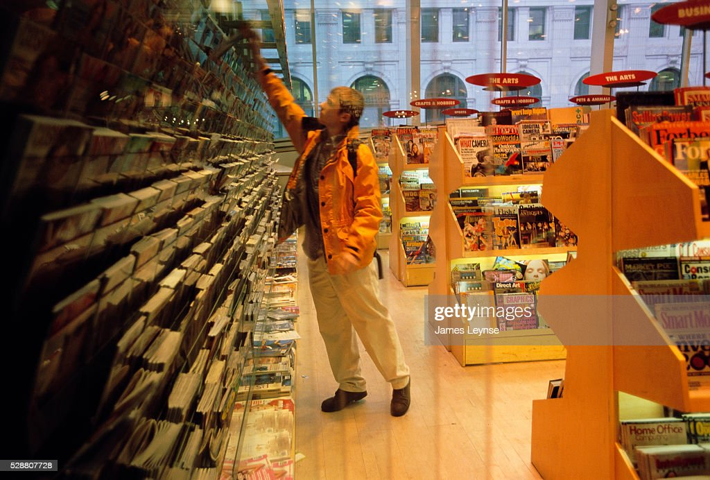 Man Browsing Through Magazines in B. Dalton Booksellers : News Photo