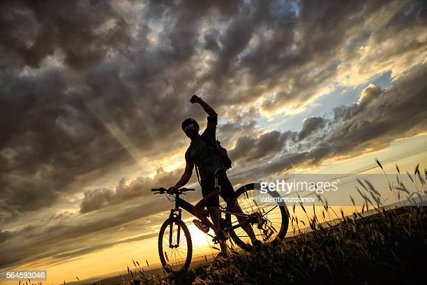 Young man reaching the top of the hill