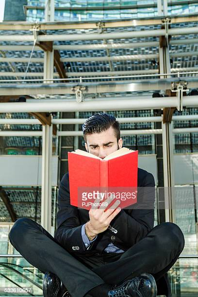 young man reading a book outdoor - pjphoto69 stock pictures, royalty-free photos & images