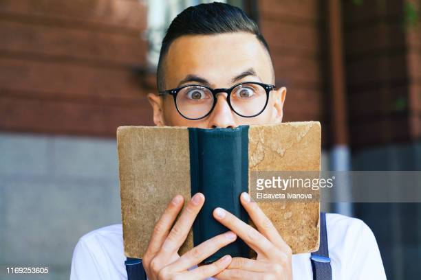 young man reading a book - poet stock pictures, royalty-free photos & images