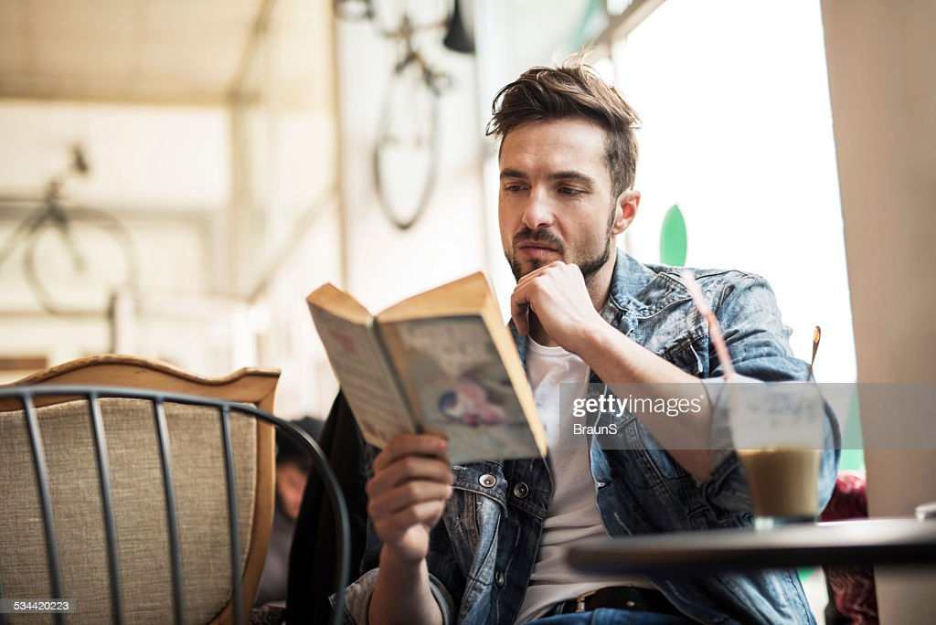Young man reading a book. : Stock Photo