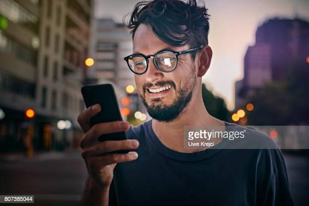 Young man reading text message
