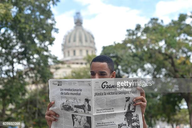 A young man reads 'Granma' the official voice of the PCC near El Capitolio a few hours later after Fidel Castro the former Prime Minister and...