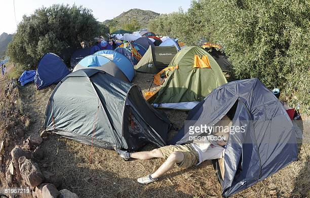 A young man reads in his tent during the Benicassim international music festival one of Europe's biggest annual music gatherings on July 17 2008 in...