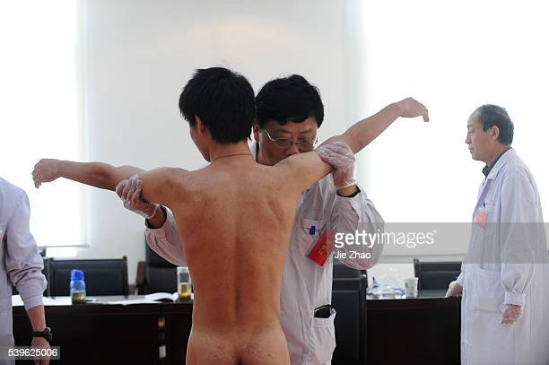 A young man receives a medical examination for the People's Liberation Army in Hefei Anhei province November 1 2009 VCP