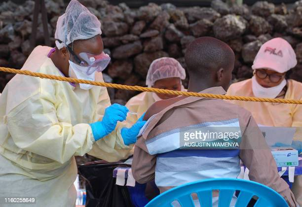 A young man receives a vaccine against Ebola from a nurse in Goma on August 7 2019 Three cases of the deadly virus was detected in the border city of...